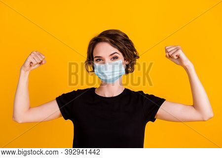 Close Up Portrait Of Attractive Strong Girl Demonstrating Muscles Wear Facial Mask Isolated Yellow C