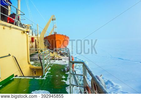 Excursion to the Arctic sea icebreaker. Unforgettable excursion to the arctic tourist cruise. Arctic in winter. Dim northern sun. The concept of active and extreme tourism