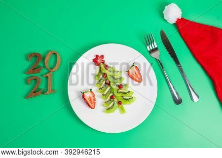 2021 Christmas Tree Of Vegetable And Fruit; Kiwi, Strawberry And Pomegranate Seed With Fork And Knif