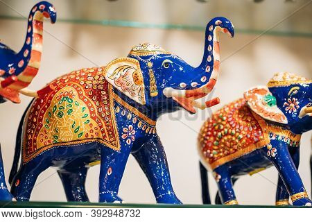 Goa, India. Painted Elephant Souvenir Of Porcelain On Shelf In Store. Goods For Tourists.