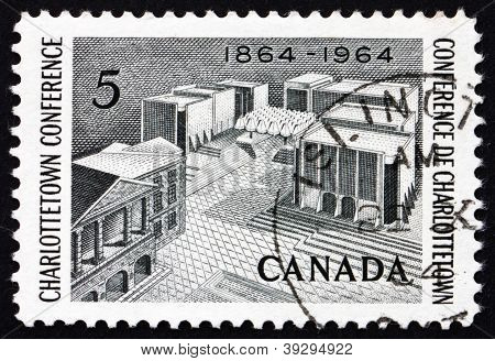 a stamp printed in the Canada shows Fathers of Confederation Memorial, Centenary of Charlottetown Conference, circa 1964 poster