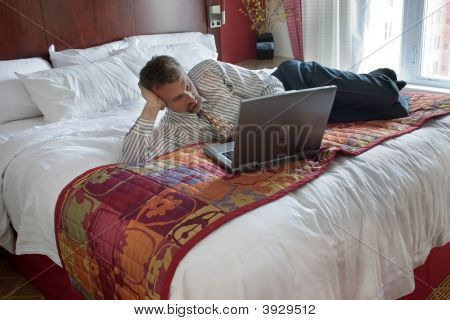 Business Man Working On Bed
