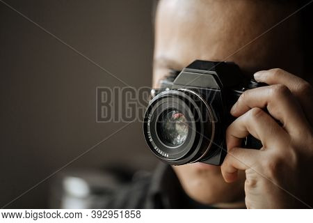 Closeup On Man Taking A Picture On A Pentax Film Camera