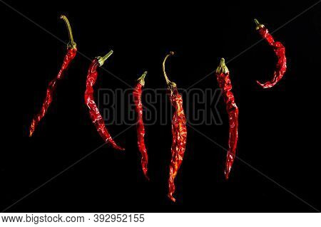 Red Hot Dried Pepper Isolated On A Black Background. Chili Peppers, The Ingredient, The . Beautiful