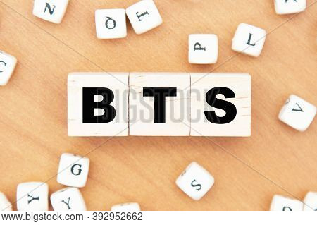 Word Concept Written On A Light Table And Light Background. Concept Word Bts On Cubes On A Beautiful