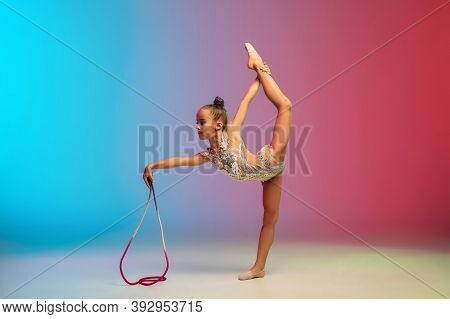 Tender. Little Caucasian Girl, Rhytmic Gymnast Training, Performing Isolated On Gradient Blue-red St