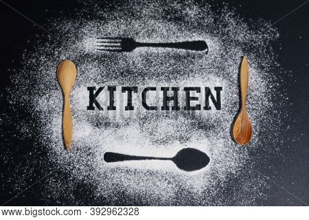 Images Of Forks And Spoons On A White Flour Background. Two Wooden Tablespoons. The Inscription Is A