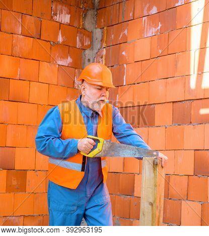 Man In Hard Hat. Worker In Helmet. Repairman On Construction. Advertising. Repairman. Builder In Con