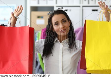 Joyful Woman At Home Raised Up Shopping Bags. Virtual Meetings With Buyer During Pandemic. Variety A