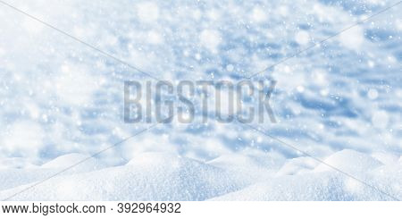 Falling Snow, Snowflakes. Snowdrift On A Blurred Blue Background. Cold Winter.