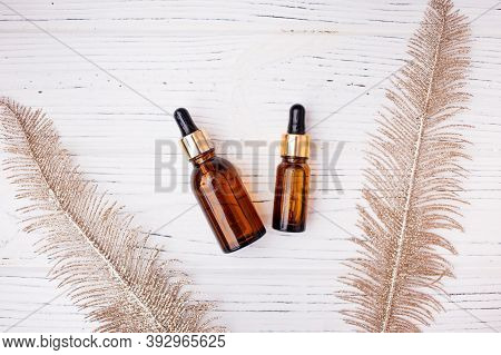 Flat Lay Of Dropper Glass Bottle Skincare Essential Oil Products For Mock Up In Minimal Style With O