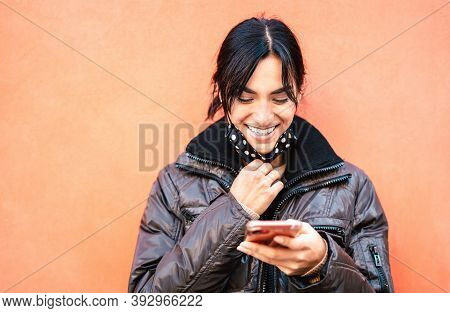 Happy Millenial Woman Smiling With Open Face Mask After Lockdown Reopening - New Normal Lifestyle Co