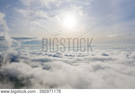 Aerial View Of Sunrise Above Fluffy Sea Fog Misty Clouds With Mountain Hill From Phu Tub Berk, Khao