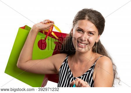 Friendly Adult Woman Customer Carrying Colourful Shopping Bags Wearing Casual Summer Modern Outfit I