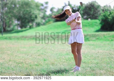 Woman Golfer Makes Hit With Golf Club. Golf Hobby Concept