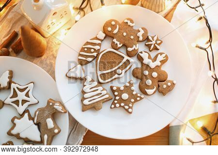 Decorated Christmas Gingerbread Man, Tree, Star And Reindeer Cookies With Frosting, Flat Lay
