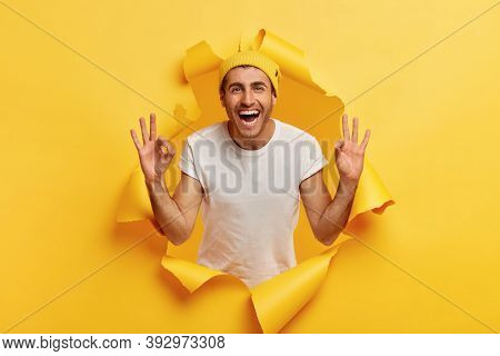 No Problem Concept. Happy Carefree Assured Caucasian Man With Cheerful Facial Expression, Assures Ev