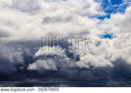 Bright Blue Sky With Dramatic Cumulus Clouds Lit By The Daytime Sun. Abstract Backdrop.