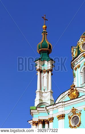 Close-up View The Top Of Ancient Saint Andrew Church Against Blue Sky. It Is A Major Baroque Church.
