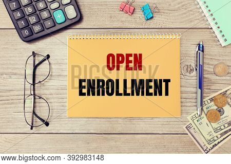 Text Writing Open Enrollment. Calculator, Money And Glasses On The Table