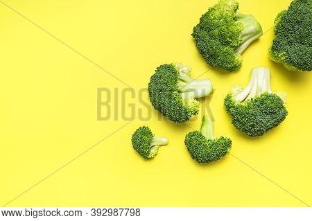 Fresh Raw Green Broccoli On Yellow Background. Healthy Vegetables, Diet Vegan Organic Food, Vitamins