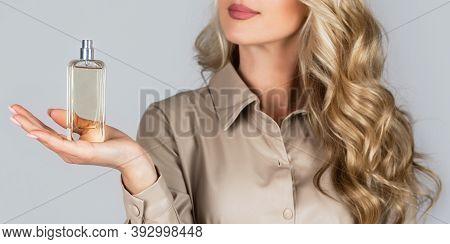Woman With Bottle Of Perfume. Woman Presents Perfumes Fragrance. Beautiful Girl Using Perfume. Perfu