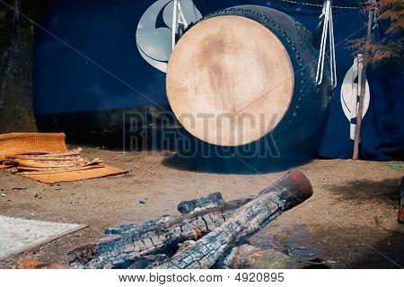 Taiko Drum Behind Smoking Embers