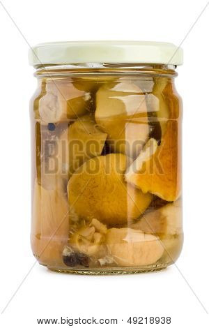 Glass jar with pickled cepe mushrooms