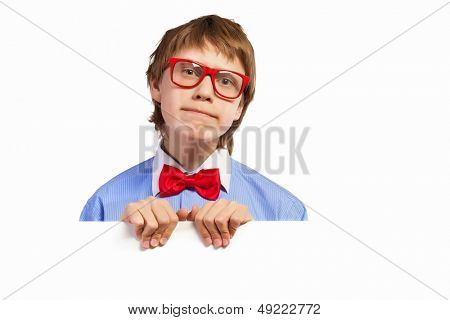Image of confused boy holding white square. Place for advertisement poster
