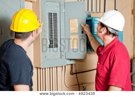 Repairmen Examine Electrical Panel