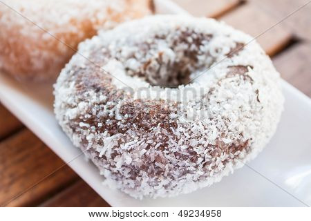 Close Up Chocolate Coconut Donut On White Plate