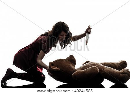 one caucasian strange young woman killing her teddy bear  in silhouette white background