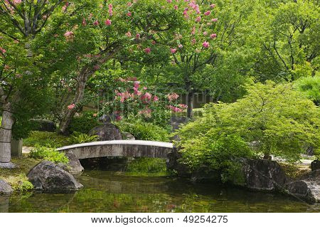 Japan Himeji Himeji Koko-en Gardens stone bridge over stream