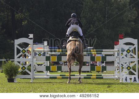 Horse jump a hurdle in a competition poster
