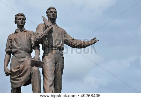 Old Statue Of Two Labours From Epoch Of Socialism.
