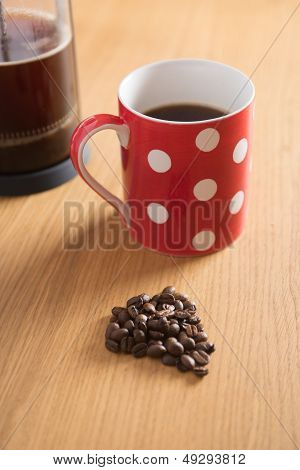 Coffee Beans, Cafetiere And Red Spotty Mug