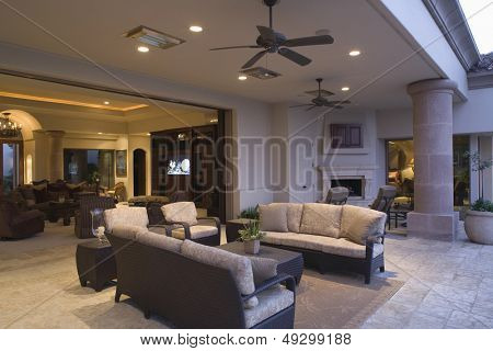 Outdoor sitting area with view of living room in the background