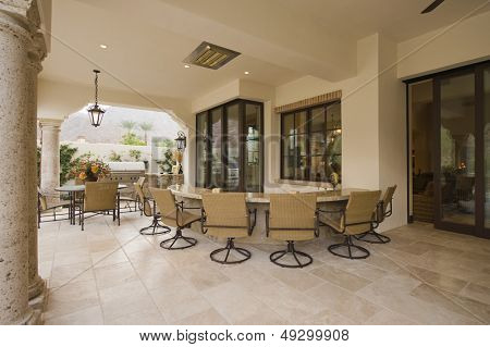 Swivel armchairs at bar area of an outdoor room home
