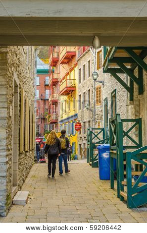 QUEBEC CITY, CANADA, OCTOBER 13, 2013 - tourists visiting alleys in Old Town