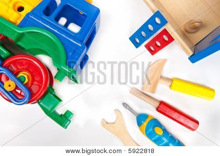 Repairing toy train with toy toolset