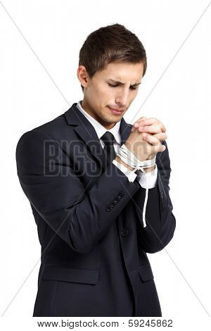 Half-length portrait of businessman with tied hands, isolated on white. Concept of slavery and hard work