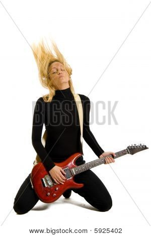 Girl Playing Her Electric Guitar On Knees