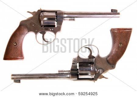 A genuine .22 caliber Colt Police Target Pistol with .22 caliber shells. The Perfect image for all  your .22 pistol gun needs. Isolated on white with room for your text.