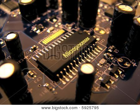 Microchip On The Printed Circuit Board PCB With Capacitors