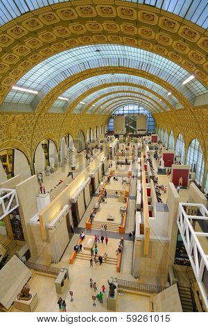 PARIS, FRANCE - SEPTEMBER 12, 2013: People in the Musee d'Orsay. Opened in 1986, the museum houses the largest collection of impressionist and post-impressionist masterpieces in the world