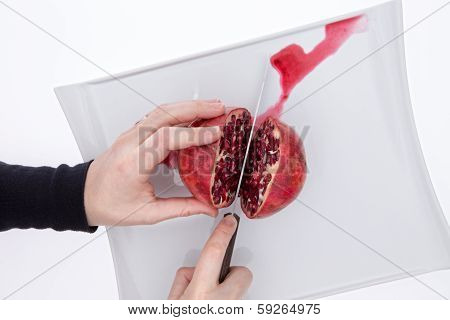 Man Or Chef Cutting A Pomegranate