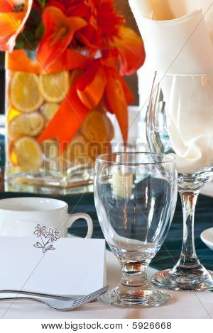 Table Place Setting With Colorful Center Piece And Place Card