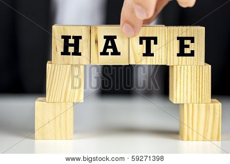 Bridge Of Cubes With Word Hate Written On Them
