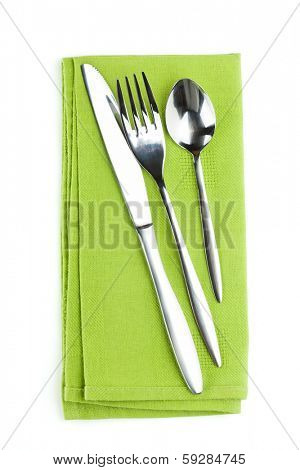 Silverware or flatware set of fork, spoon and knife on towel. Isolated on white background