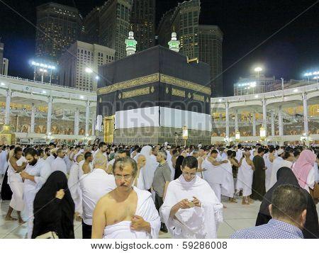 MECCA, SAUDI ARABIA - OCTOBER 13: Muslim pilgrims, from all around the World, revolving around the Kaaba on October 13, 2013 in Mecca, Saudi Arabia.